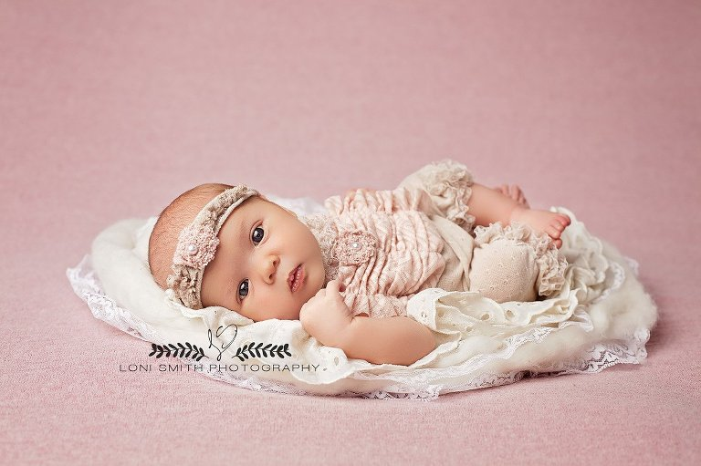 Image created by Utah newborn photographer Loni Smith with wide awake baby