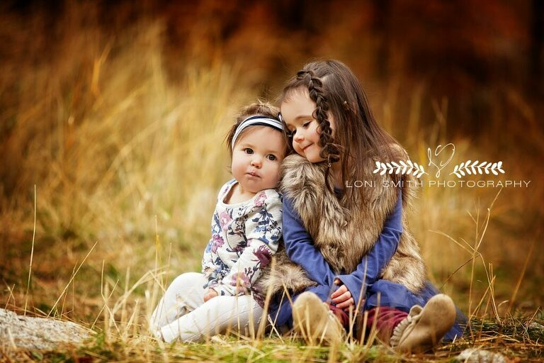 Picture of sisters in outdoors Utah taken by Loni Smith photography